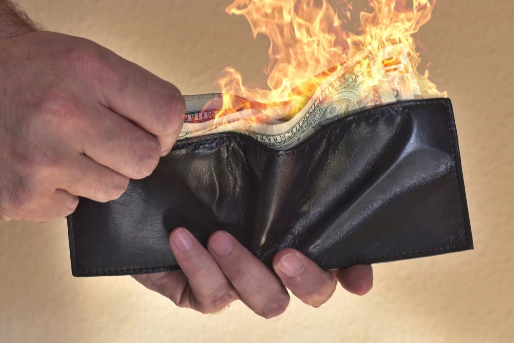 wallet full of burning money