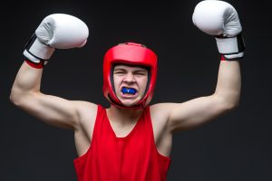 writing/boxing champion in red form and white boxing gloves